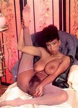 Vintage photo of busty ebony beauty with a hairy pussy