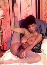 Vintage photo of busty ebony beauty with a hairy pussy