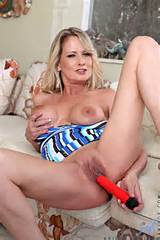 Bridgette Lee exposes her cougar pussy from Anilos